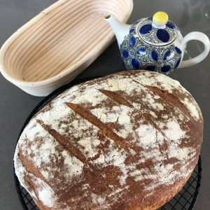 Sourdough, teapot and a proofing basket