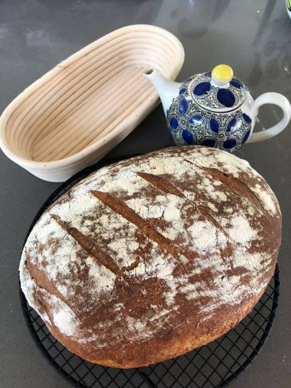 Sourdough, teapot and a proofing basket